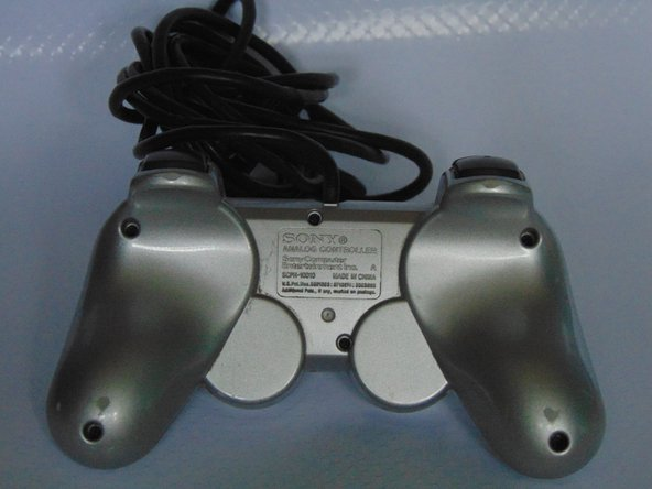 On the back of the controller there is screw holes