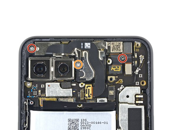 Remove the three T3 Torx screws securing the front camera and sensor assembly: