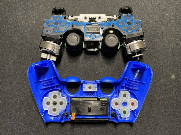 To reassemble the controller, place the back cover onto the motherboard.