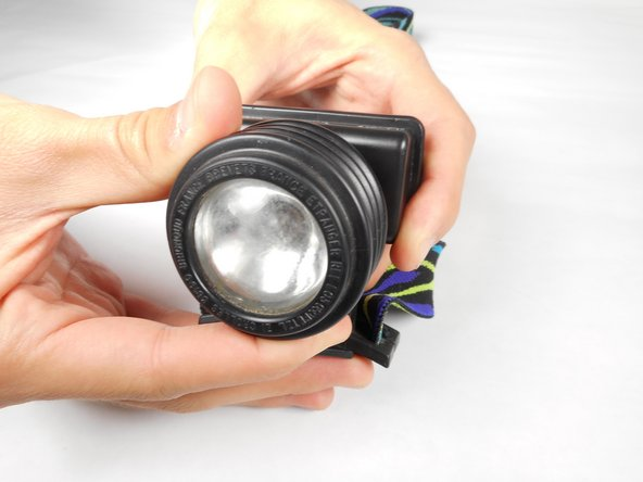 Turn the lens piece counterclockwise (left) until it is fully extended.