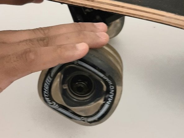 Test the wheel by spinning it on the board to check that it moves freely.
