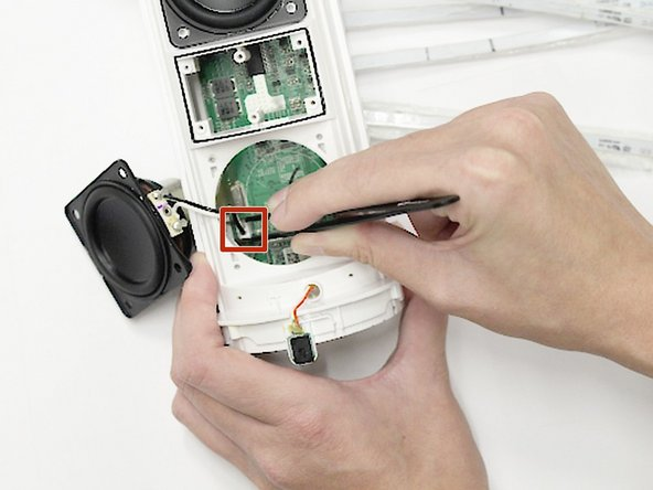 Use the straight tweezers to disconnect the speakers from the motherboard.