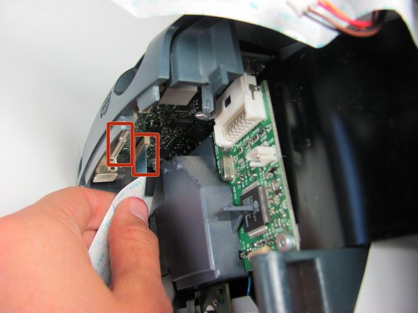 Gently grasp and unplug the two white ribbon cables from the printer body.