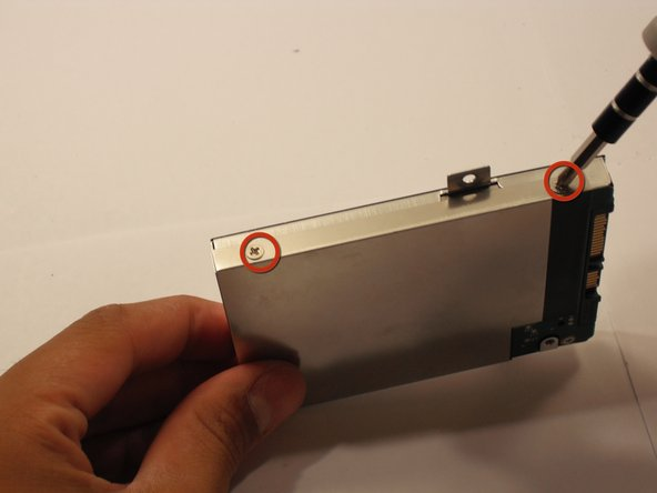 Remove the four 3.9 mm Phillips #1 screws from the hard drive casing.