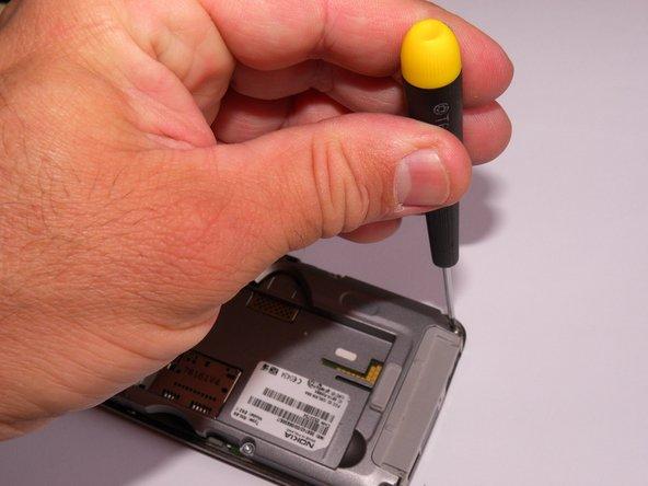 Remove the screws using Torx T6 screw driver.