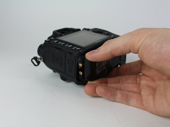 Gently pull the bottom cover off of the camera body.