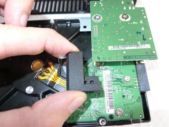 Remove the rubber piece from the  SATA/USB bridge logic board.