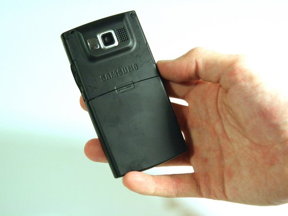 Hold the device with the screen facing away from you and the camera towards you.
