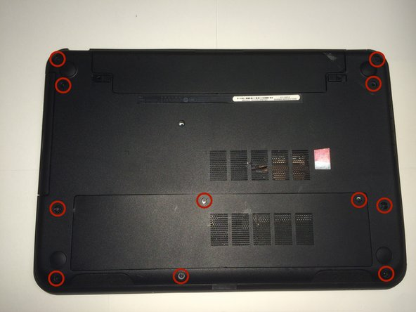 Before flipping the laptop right-side up, remove screws holding the back plate to the laptop frame