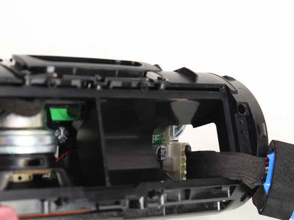 Pull out the battery enough to expose the battery's wire connector.