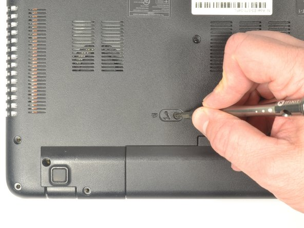 Insert the pointed end of a spudger into the battery release.