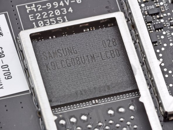 What is this? A Samsung K9LCG08U1M 8GB NAND Flash chip?