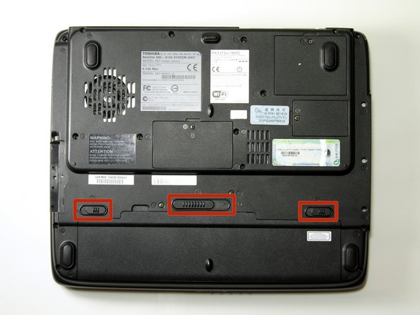 Flip the laptop over so the bottom is facing up.
