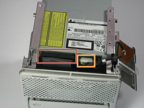 Slowly lift up the optical drive and remove the IDE cable.
