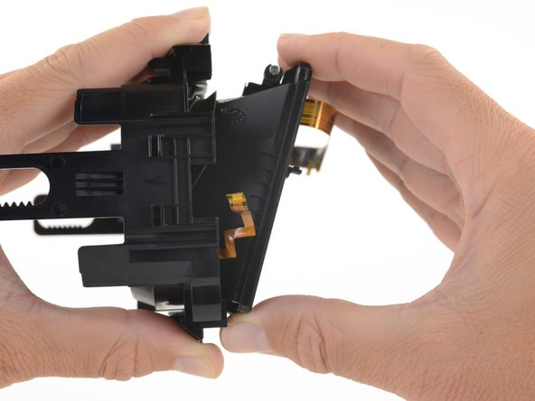 Hinge the OLED and lens frames down and away from the focus knob end of the eyepiece midframe.