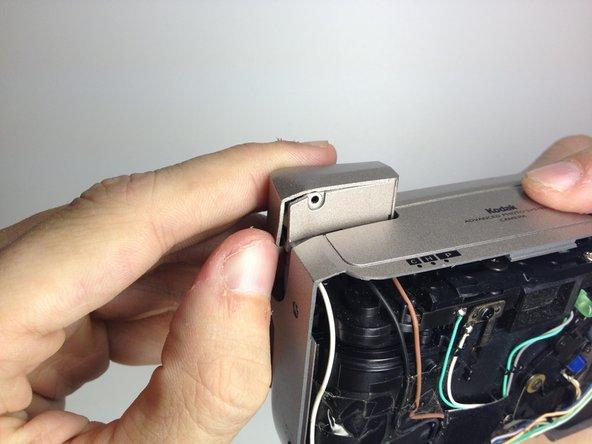 Remove the flash cover.