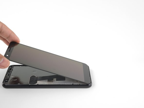 With all of the adhesives cut, flip the attached screen glass side down and rest it on top of the phone. The screen flex cable should be loosely arched.