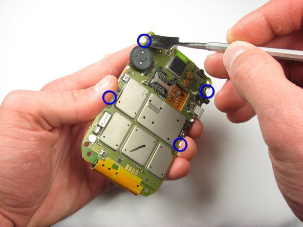 Using a metal spudger, push back on the four clips holding the LCD screen to the logic board.