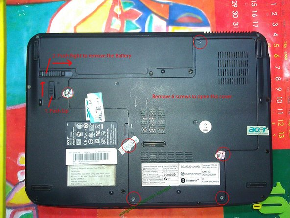 Now, turn the laptop upside-down. We push 2 buttons to take out the battery. Then remove 6 screws to open the cover     as shown in the picture