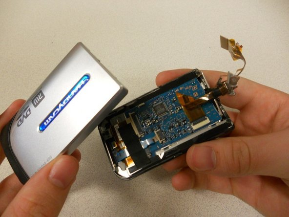 Pull off the silver cover on the screen, which will reveal the circuit board from behind the screen itself.