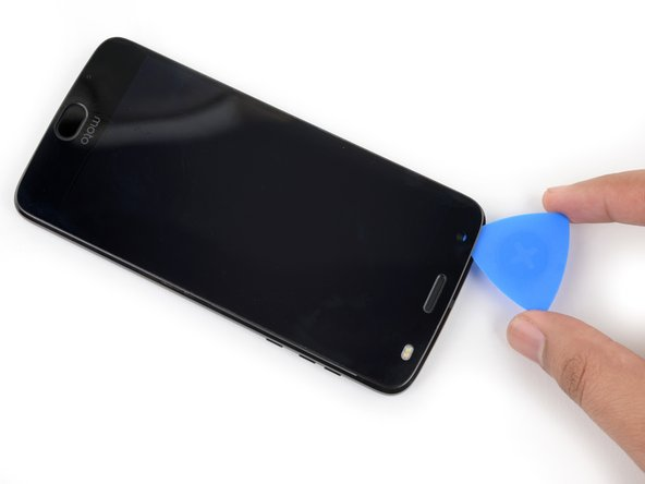 Slide your tool around the top edge of the screen assembly and slice all along it to slice through its adhesive.