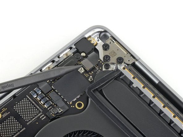 Disconnect the headphone jack flex connector by prying it straight up from the logic board.