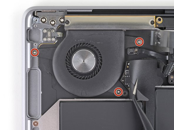 Use a T5 Torx driver to remove the three 2.7 mm screws securing the fan.