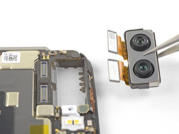 Remove the rear-facing camera module.
