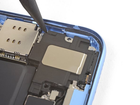 Insert a spudger under the top edge of the speaker near the edge of the iPhone's case.