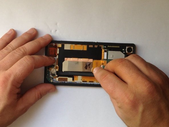 With the sharp end of the plastic tool carefully subtract the module from the phone housing.