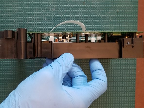 After removing the lower shell DO NOT place the drive down as you typically would. You may damage the lower ribbon cable rendering the drive useless