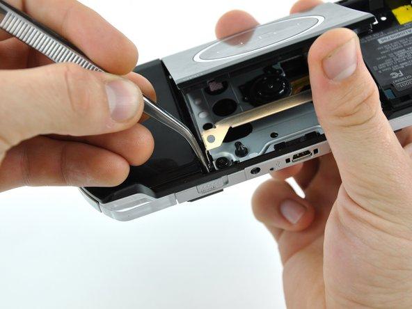 Flip the PSP 300xc over and open the UMD door.