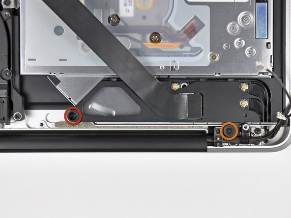 Remove the following two screws securing the AirPort/Bluetooth housing to the upper case: