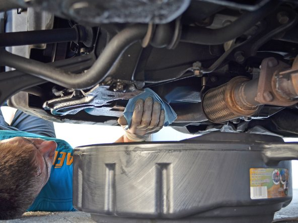 Wipe the area on the oil pan around the drain plug hole with a clean rag or towel.