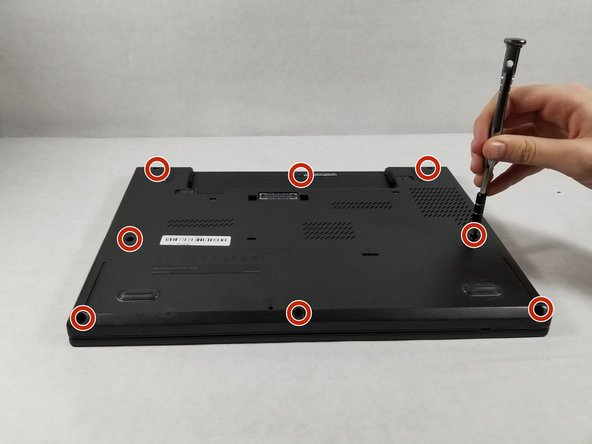 Using a Phillips #1 screwdriver, remove the eight screws securing the backplate.