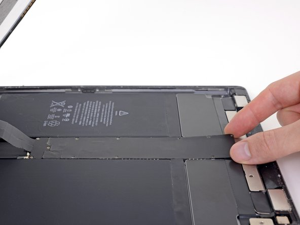 Lift the logic board EMI shield from the edge nearest the top of the iPad.