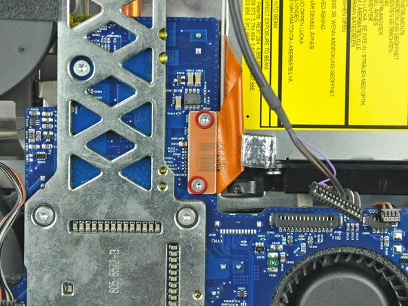 Remove the two T6 Torx screws securing the optical drive connector to the logic board.