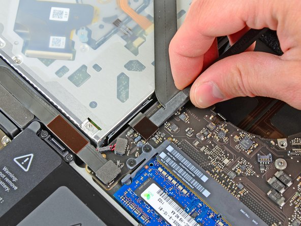 Use the flat end of a spudger to lift the optical drive connector out of its socket on the logic board.