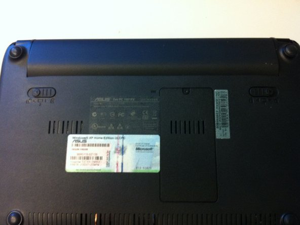 First turn the netbook upside down and slide the battery catches to release and remove the battery from the netbook