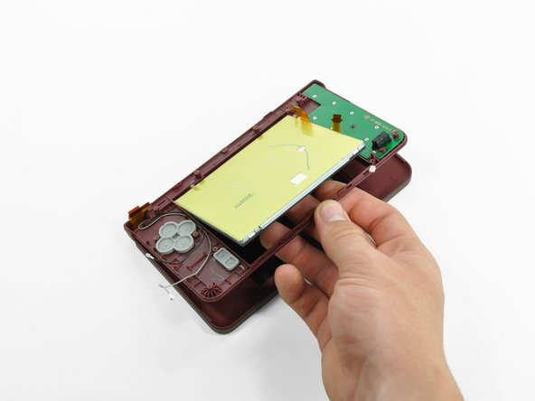 With the console still upside-down, open the DSi XL slightly.