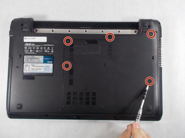 Remove the five Phillips # 0 screws from the back panel.