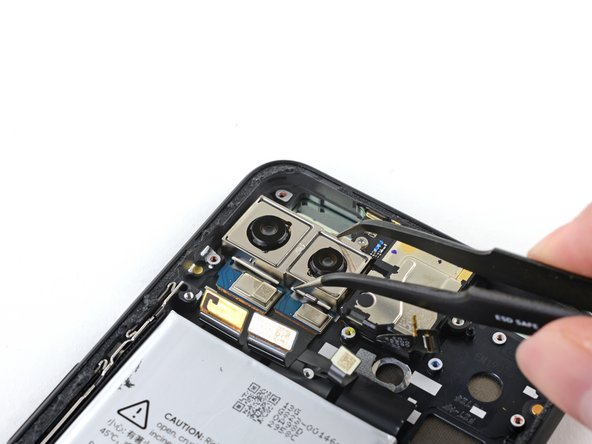 Use a pair of tweezers to remove the rear-facing camera module.