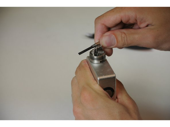 Put the screwdriver through the coil to place the coil in desired position.