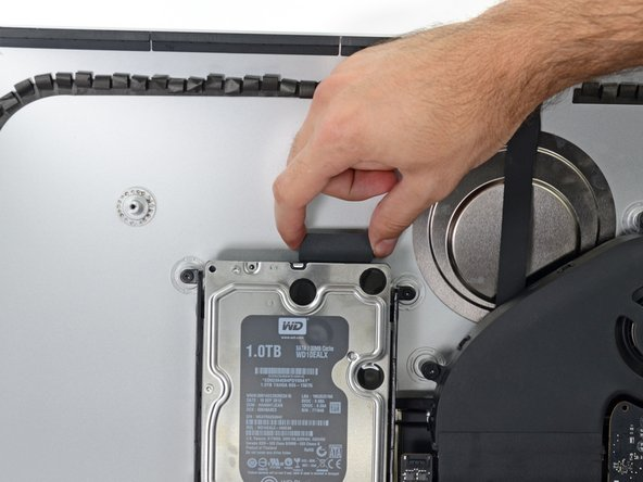 Pull straight up on the SATA data/power cable to disconnect it from the drive.