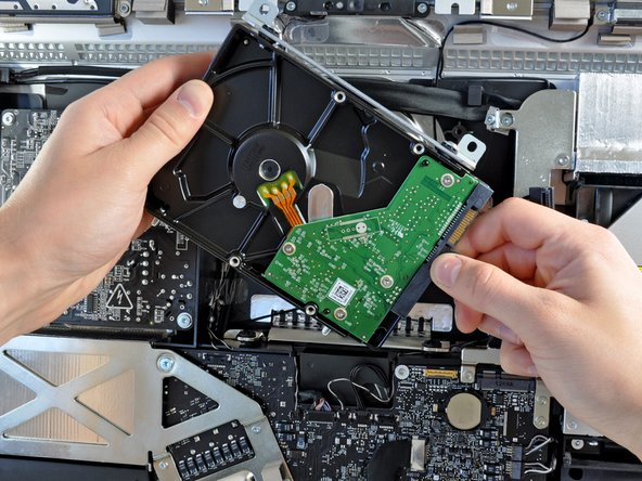 """In the next few steps, we remove many components that are very similar to the last 21.5"""" iMac."""
