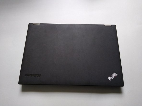Flip the laptop over so that the bottom of the laptop is facing you.