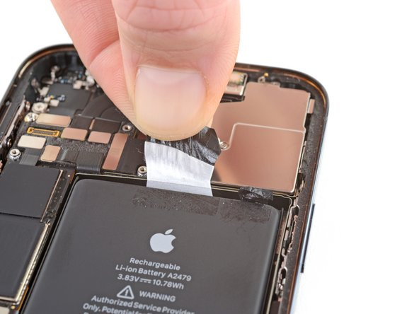 Using the same procedure as before, pull the remaining two tabs, one at a time, to stretch and remove the remaining adhesive strip holding the battery in place. Try not to snag the adhesive on anything.