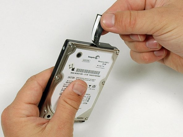 There is a black pad on one end of the hard drive that you should peel off and transfer to your new hard drive.