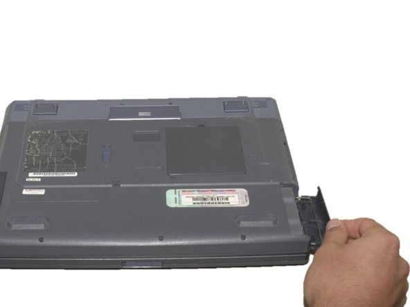 As shown by the arrow, slide the plastic cover up and then pull out and downwards.