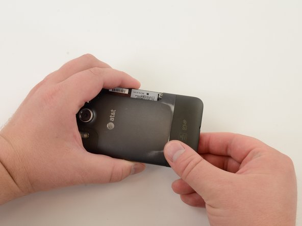 Remove SIM card cover by simultaneously squeezing cover and pulling it off of the phone.